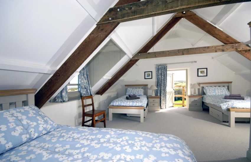 Martins Haven holiday cottage sleeping 5 - first floor triple bedroom with sea views