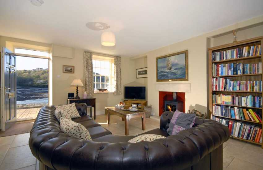 Newport Pembrokeshire holiday home - sitting room with wood burning stove and harbour views