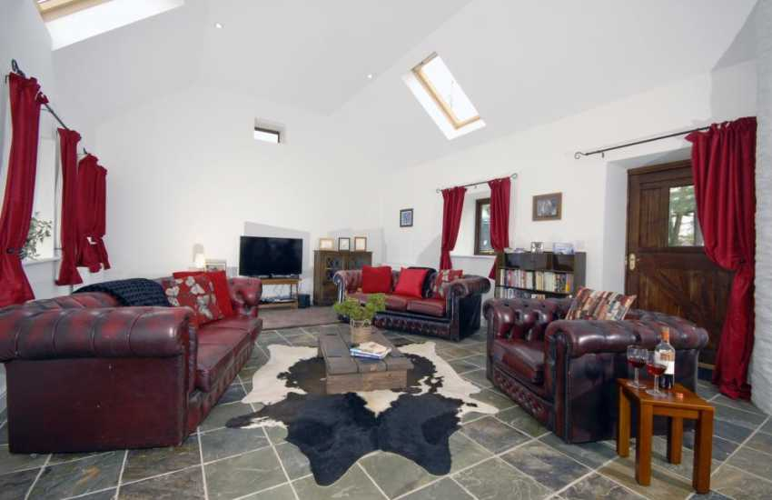 Teifi Valley rural cottage - spacious lounge with Chesterfield sofas