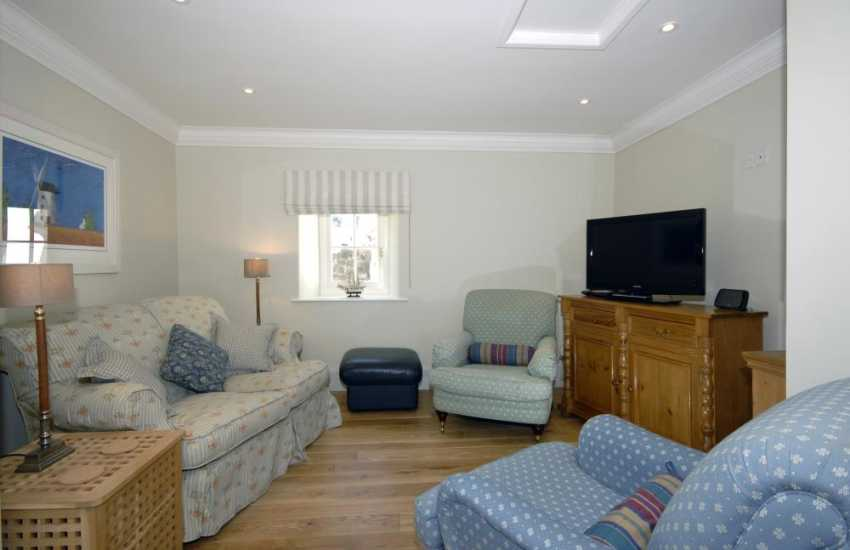 Aberaeron self catering holiday home - sitting room with Smart T.V.