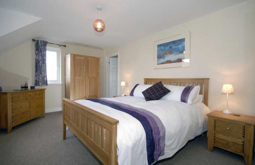 Newgale luxury holiday house - king size master bedroom with countryside views.