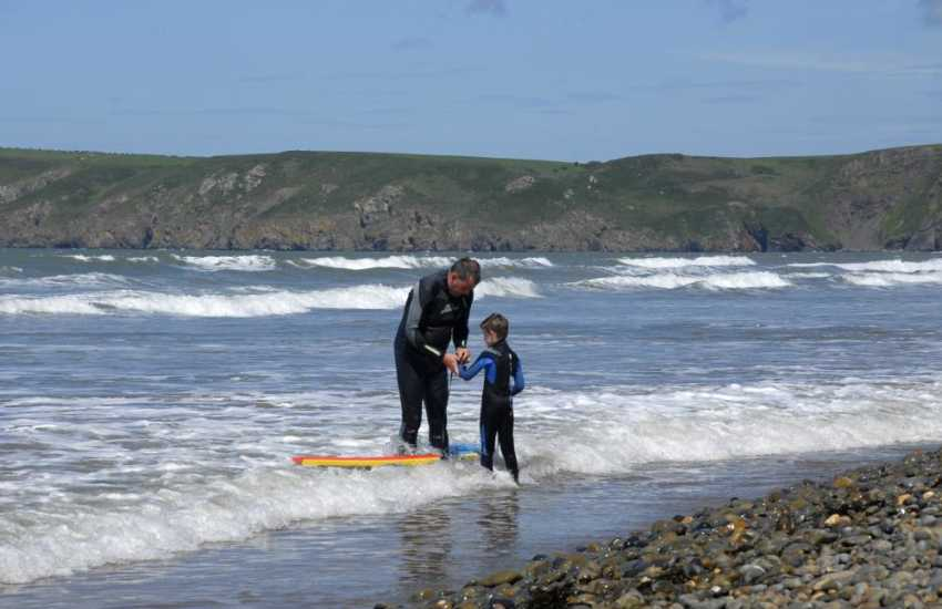 Newgale with its 2 miles of golden sands is a firm favourite for surfing, body boarding and kite surfing