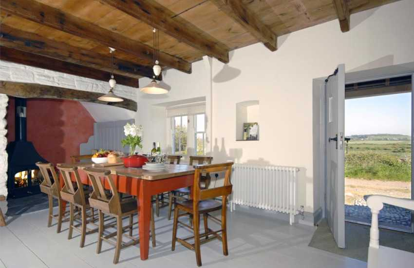 Self catering cottage near Whitesands Beach - cosy dining area with wood burning stove