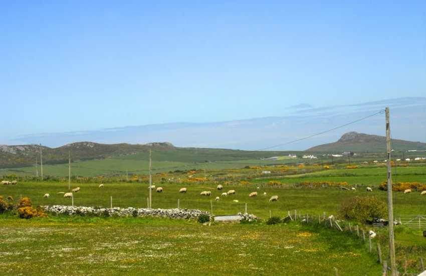 Fabulous views across the surrounding farm and moorland to Carn Penberry from the gardens