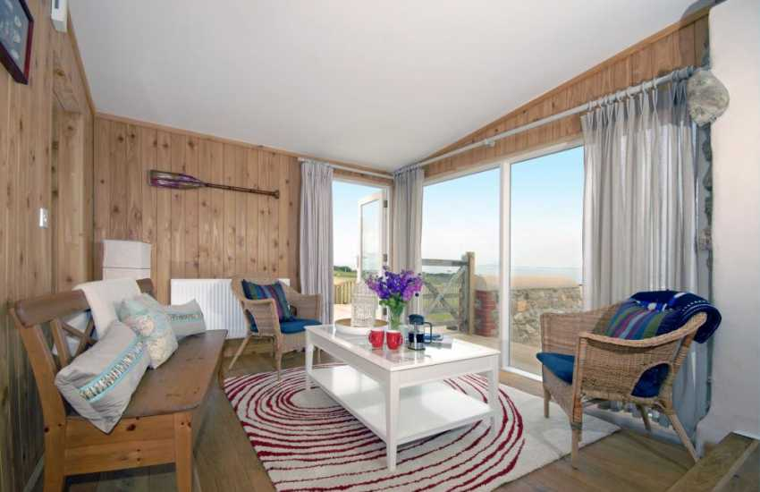 Skomer Pembrokeshire holiday home - sitting/sun room with patio doors to deck and coastal sea views