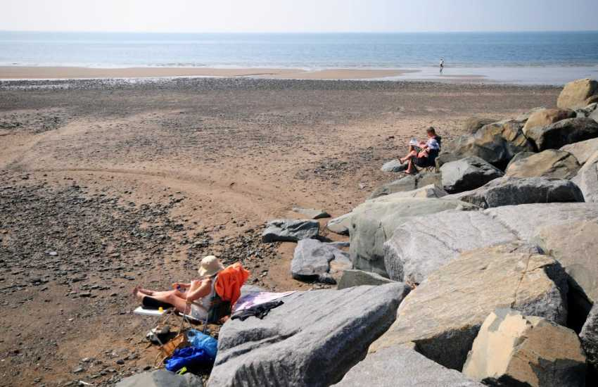 Relaxing on the quiet beach in Tywyn