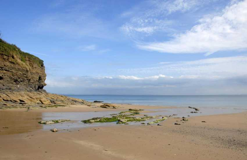 Walk from the garden onto Waterwynch Beach  - a beautiful sheltered sandy cove at low tide