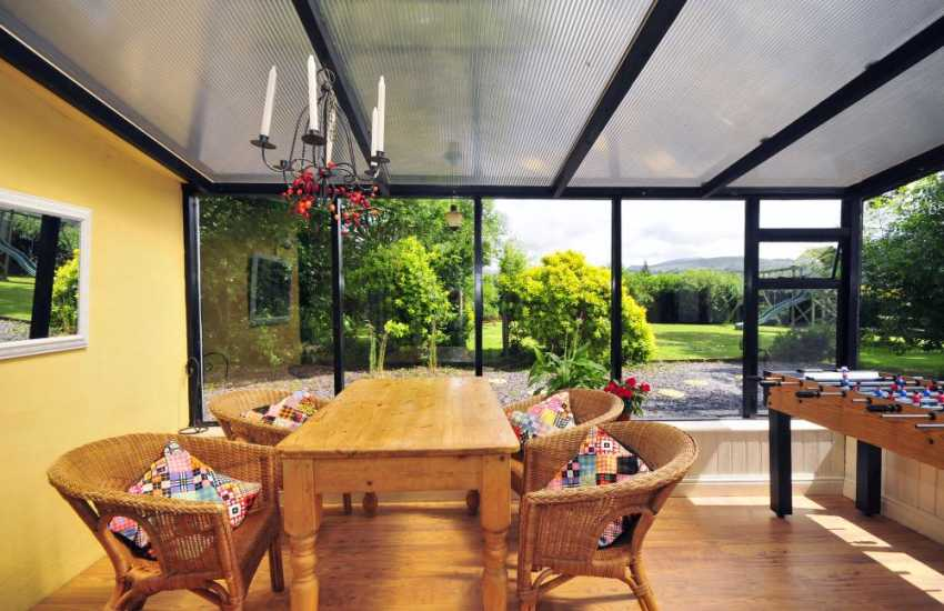 Conservatory in large farmhouse accommodation - North Wales