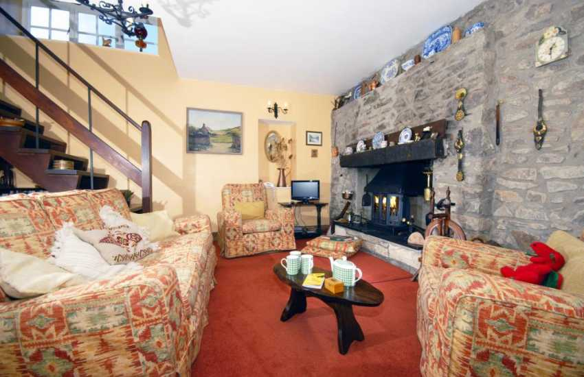 Solva holiday home - open plan living area and wood-burning stove