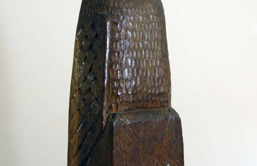 Carved wooden owl sits on the newel post on the landing