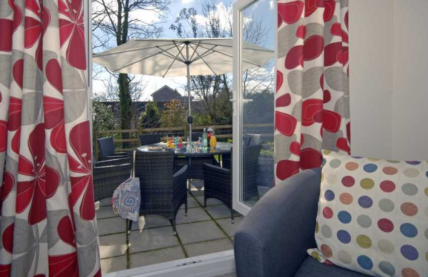 North Pembrokeshire holiday house - sitting room with French windows to the patio