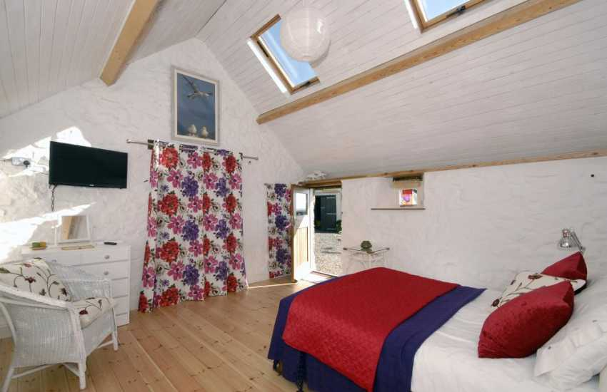 St Brides Bay holiday cottage - ground floor double with door to gardens