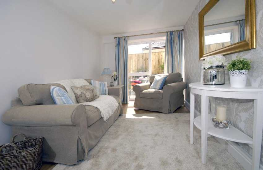 Cosy Pembrokeshire holiday cottage - sitting room with door to the patio
