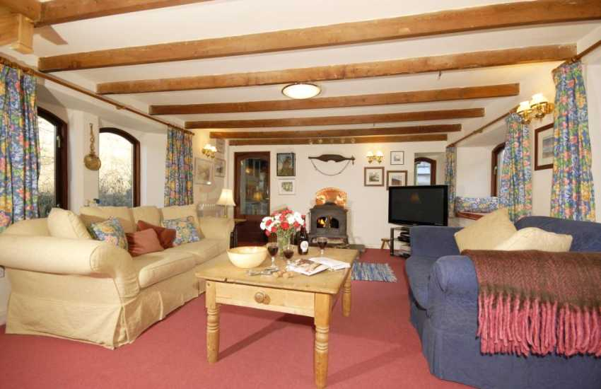 Newport holiday cottage - cosy lounge with wood burning stove