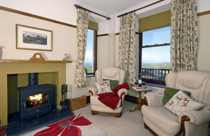 Mathry holiday home-sitting room with log burning stove and coastal views