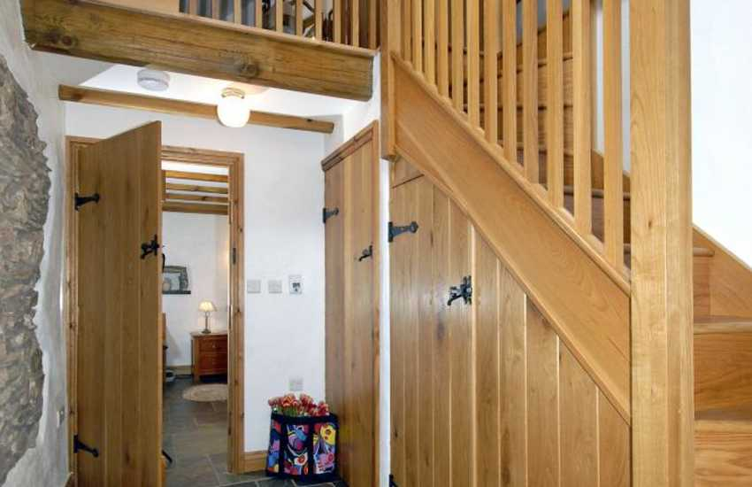 Converted barn near St Davids - hallway with galleried first floor twin bedroom