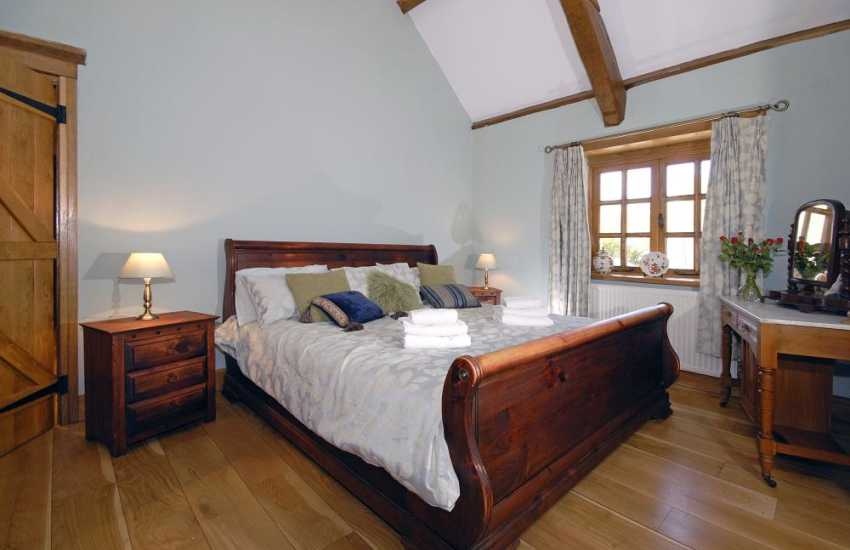 Preseli Hills holiday cottage master en-suite bedroom with 6 foot bed