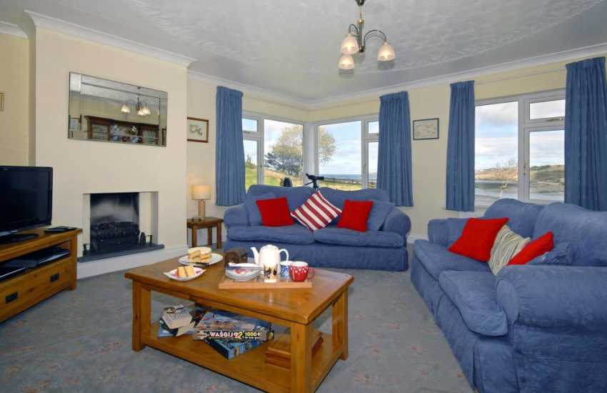 Poppit Sands, Cardigan holiday bungalow - lounge with stunning sea and estuary views through the windows