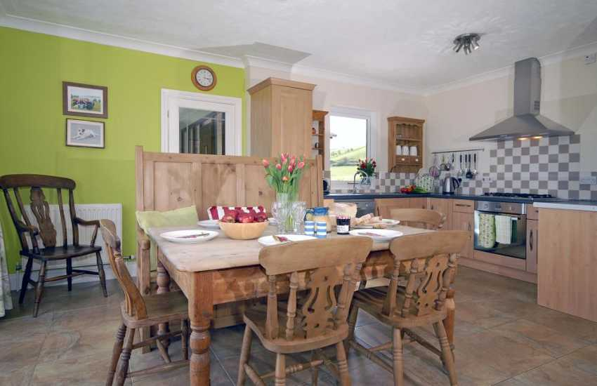 Self-catering Poppit Sands holiday home - modern open-plan kitchen/diner/sitting area