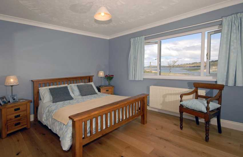 Poppit Sands holiday home with Teify Estuary views - en-suite king size master bedroom
