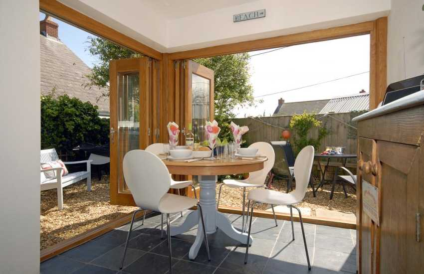 Self catering Pembrokeshire - modern dining room with folding doors to garden