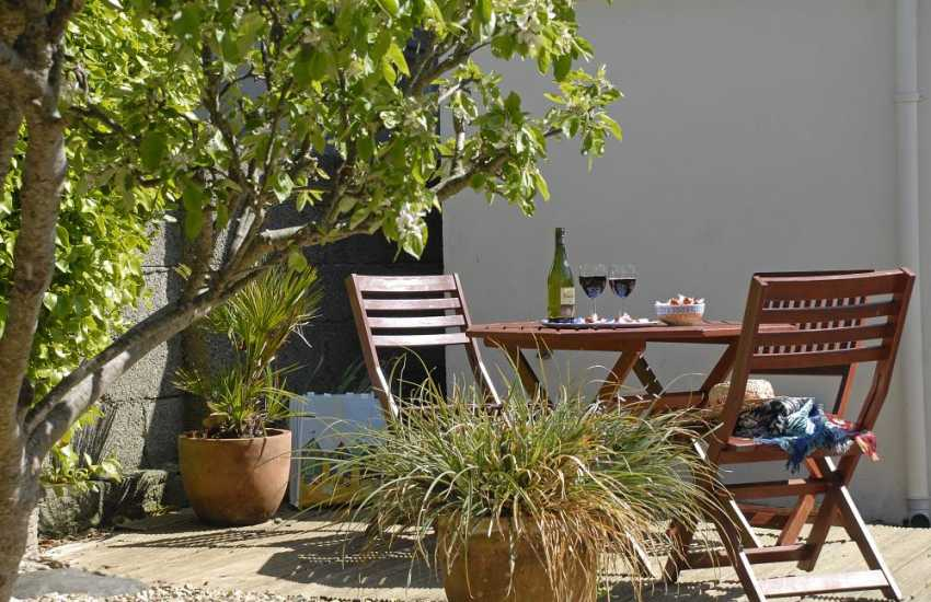 Relax in the private garden at Goat Street Cottage