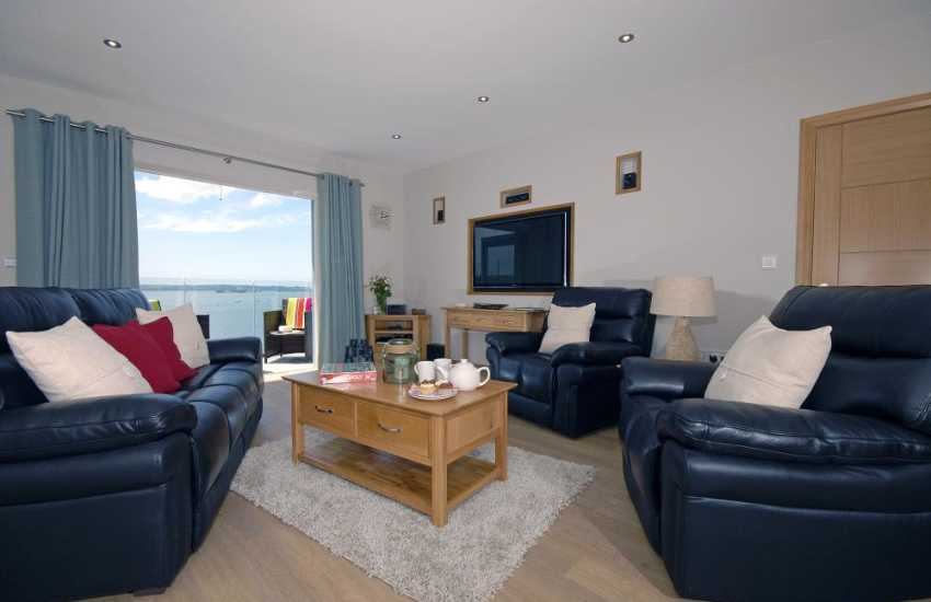 Haven Waterway holiday apartment - open plan lounge with Wi-Fi, Smart T.V and bi-folding doors to deck
