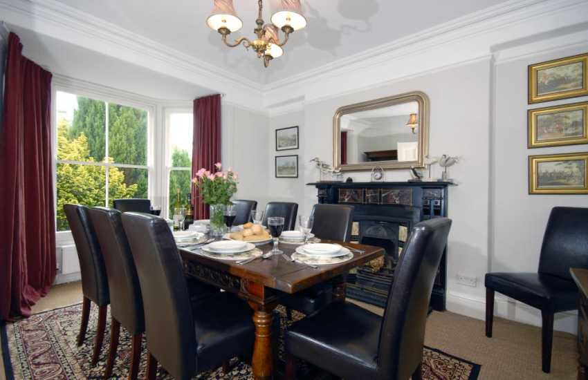 Tresaith period house for rent - elegant dining room with feature fireplace