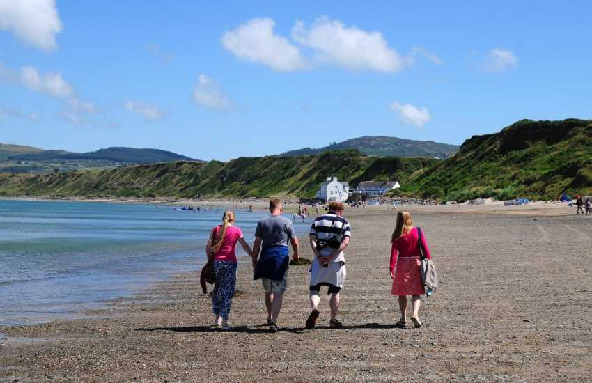 Walk to the Ty Coch pub on the beach