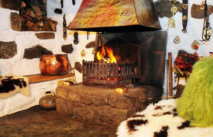 Inglenook fireplace in Elizabethan cottage near Criccieth