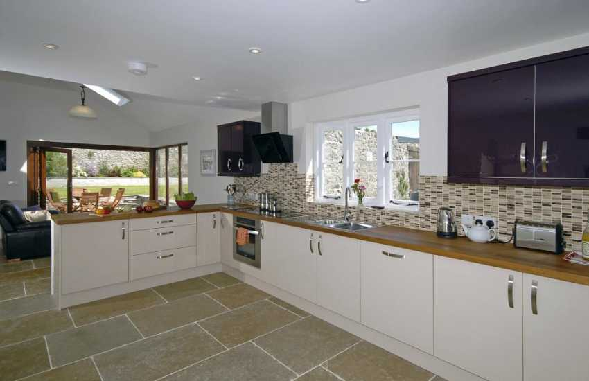 St Davids self-catering family cottage - open plan modern kitchen