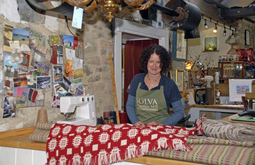 Solva Wollen Mill - the oldest working mill in Pembrokeshire with beautiful woven rugs, blankets and  other products for sale in the shop