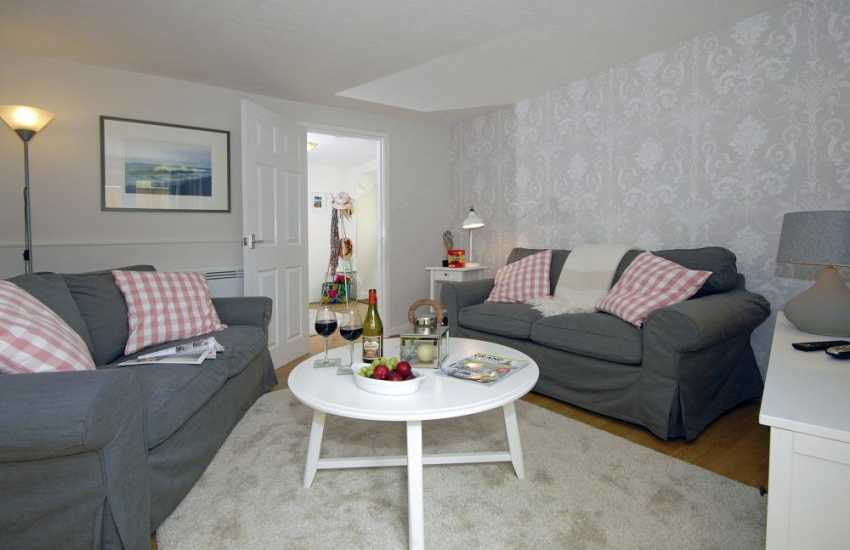 Pembroke town holiday cottage with parking  - sitting room with french doors to the patio