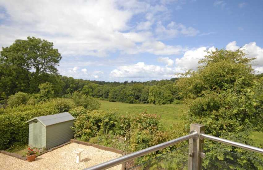 Enjoy lovely views over the Stackpole Estate from the balcony