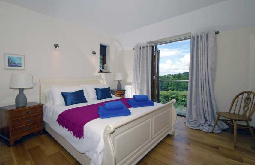 Stackpole holiday cottage - master king size bedroom with countryside views