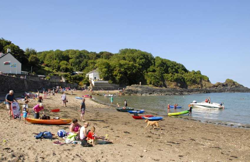 Cwm yr Eglwys is a picturesque sheltered cove popular with families for rock pooling, swimming and sailing