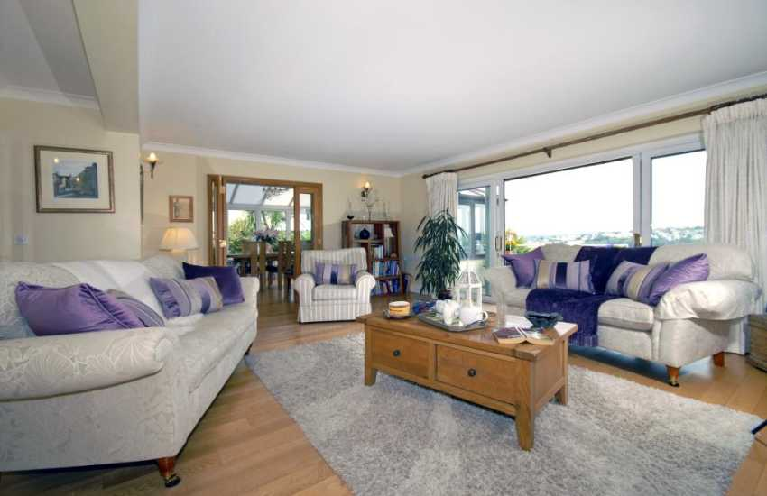 South Pembrokeshire holiday home on the Milford Haven Waterway - lounge with patio doors to the deck