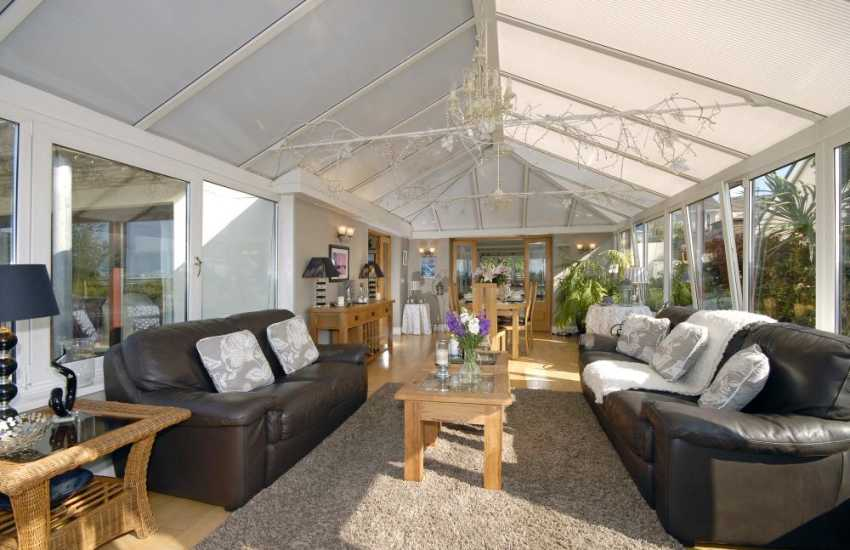 Holiday house near the South Pembrokeshire coast - conservatory dining room with river views