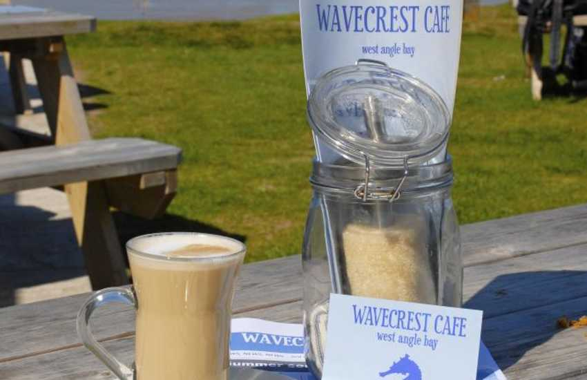 Wavecrest Cafe, West Angle Bay is in a unique beach side location. Local crab, local beers & cider, delicious homemade cakes and freshly ground coffees