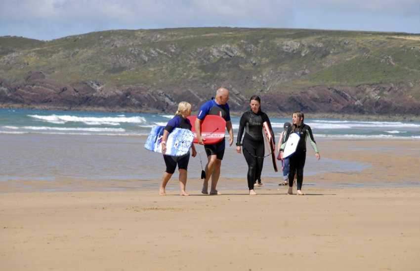 Enjoying the waves together at Freshwater West