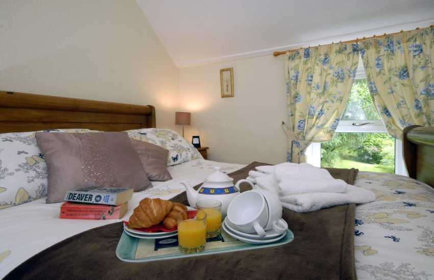 St Brides Bay holiday house -  master bedroom with garden views