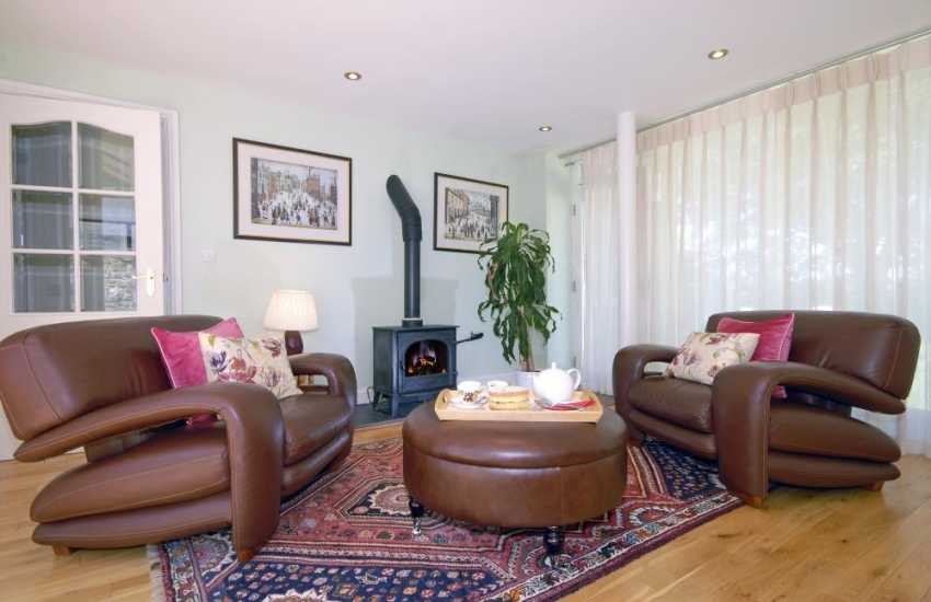 North Pembrokeshire coast Luxury holiday home - spacious lounge with glass walls and oil burning stove