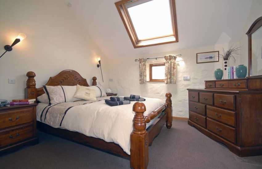 Newgale holiday cottage sleeps 4 - king size master bedroom with countryside views