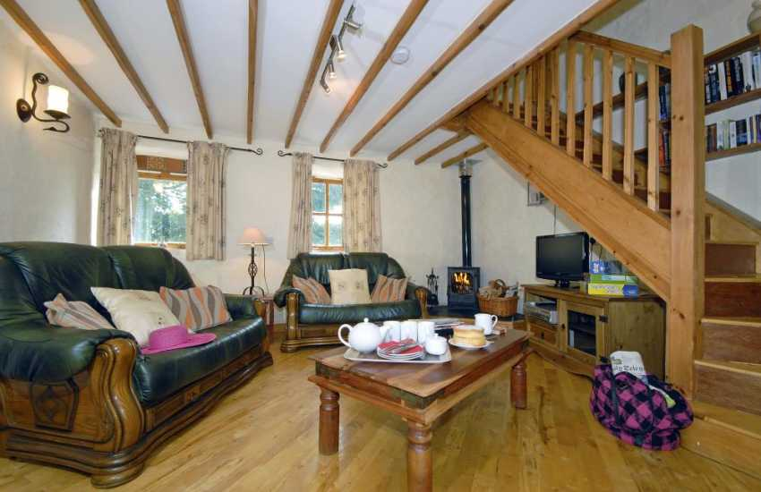 Newgale Pembrokeshire cosy holiday cottage - comfortable sitting room with log burning stove