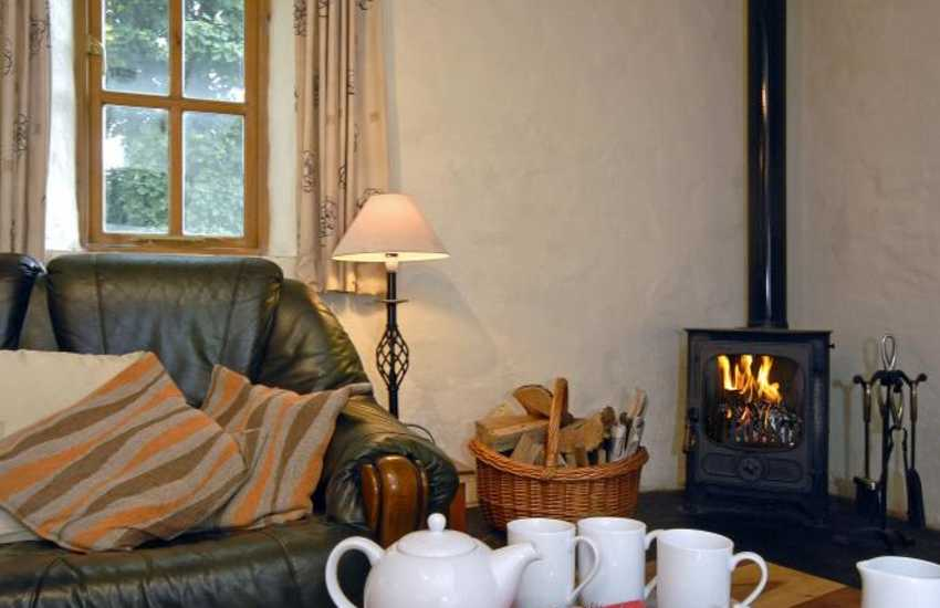 Cosy Pembrokeshire holiday cottage - comfortable sitting room with wood burning stove