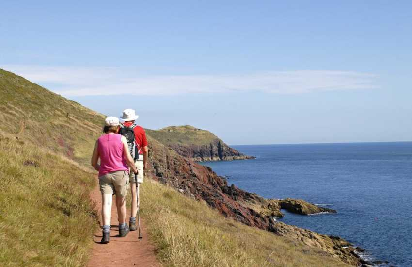Walk the Pembrokeshire Coast Path - 108 miles of stunning coast line filled with flora and fauna especially in spring