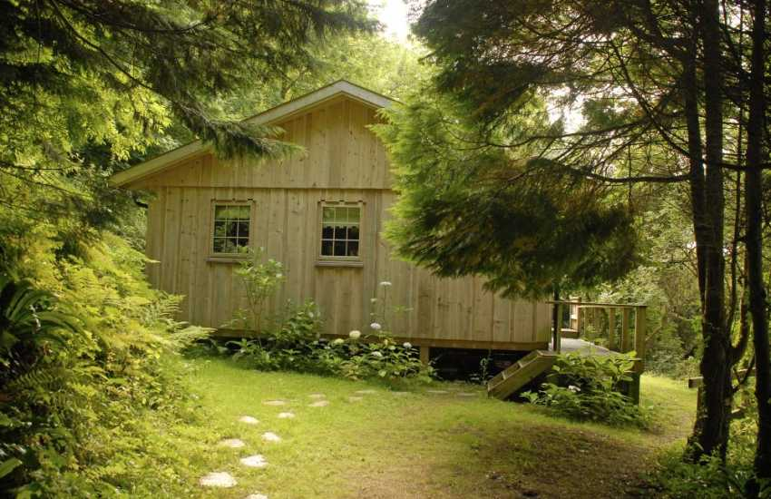 Pet friendly Cwm yr Eglwys, Pembrokeshire  - log cabin  with private gardens
