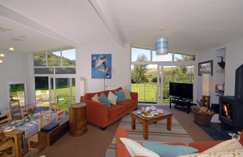Nolton Haven 1960's contemporary holiday home - open plan living/dining room with log burner