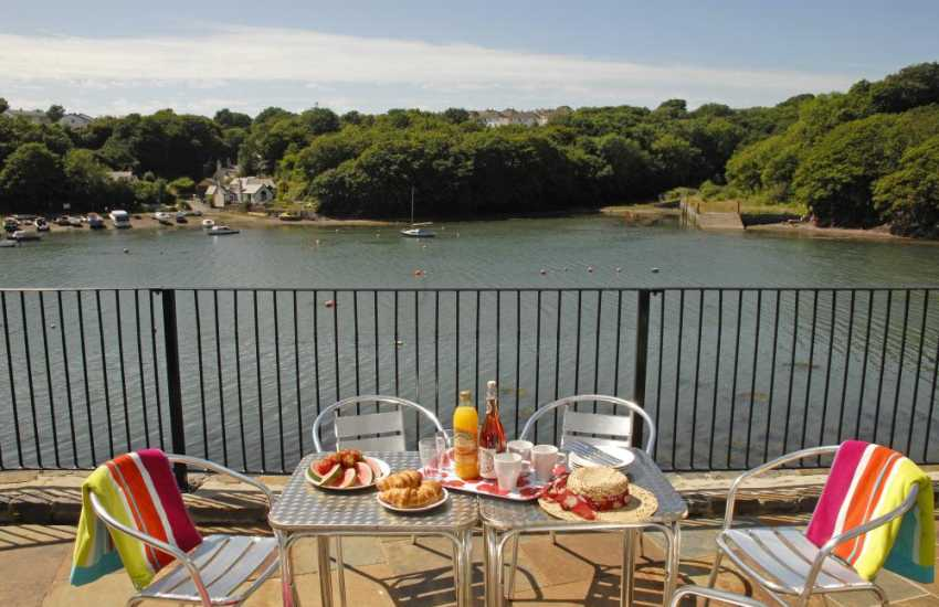 Relax and enjoy the ever-changing views over the water at Woodpecker