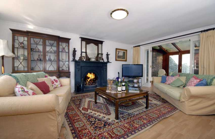 Pet friendly Southerndown holiday house near Dunraven Bay - sitting room with open fire